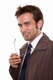 Young twenties attractive russian caucasian man. Young attractive caucasian man in his twenties holding glasses Royalty Free Stock Image
