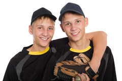 Young twin brothers holding each other royalty free stock photo