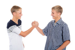 Young twin brothers shake hands. Isolated on white Stock Images