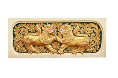 Young twin lion ,traditional thai stucco pattern with carving in temple,Chiang Mai,Thailand stock photography
