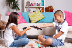 Young twins arguing about watching TV Stock Images