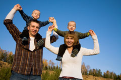 Young twins with parents Stock Photography