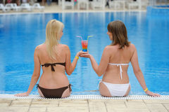 Young two girls in a bikini at the pool Royalty Free Stock Photo