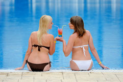 Young two girls in a bikini at the pool Stock Photography