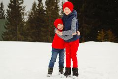 Young two happy kids playing outdoors in winter park Royalty Free Stock Image