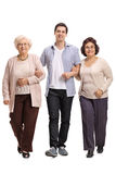 Young with two mature women walking towards the camera Royalty Free Stock Photo