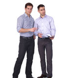 Young two men standing , isolated on white background Stock Image