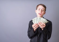 Young Tycoon Business Man Wiz Kid Fanning Money stock photo