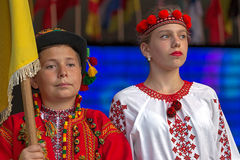 Young Ukrainian dancers in traditional costume, with national fl Stock Photos