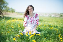 The young Ukrainian girl whit yellow flowers Royalty Free Stock Image