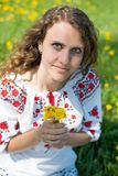 The young Ukrainian girl whit yellow flowers Stock Image