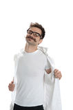 Young undressing man Stock Image