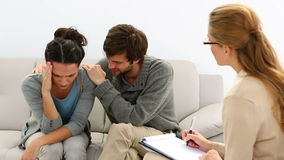 Young unhappy couple talking with their therapist. At therapy session stock video footage