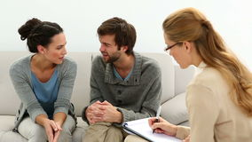 Young unhappy couple talking with their therapist. At therapy session stock footage