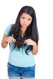 Young unhappy girl holding an empty wallet Royalty Free Stock Photography