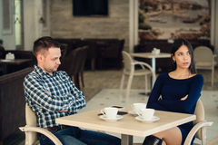 Young unhappy married couple having serious quarrel at cafe Royalty Free Stock Image