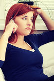 Young unhappy and upset woman talking by phone Stock Photos