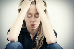 Young unhappy woman in depression Royalty Free Stock Photo