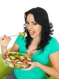 Young Unhappy Woman Eating a Fresh Crisp Mixed Garden Salad Stock Photography