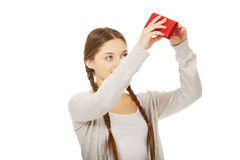 Young unhappy woman with empty purse. Stock Photography