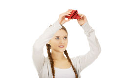 Young unhappy woman with empty purse. Royalty Free Stock Image