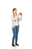 Young unhappy woman with empty purse. Royalty Free Stock Photography
