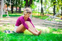 Young woman feeling pain in her foot during sport workout in the royalty free stock photography
