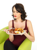 Young Unhappy Woman Holding a Plate of Full English Breakfast Royalty Free Stock Image
