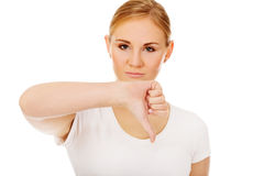 Young unhappy woman showing thumb down Stock Photos