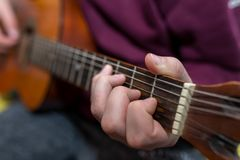 Young unidentifiable musician playing on the guitar royalty free stock images