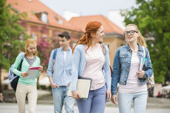 Young university friends walking on street Stock Photos