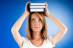 Young university student with many  textbooks Royalty Free Stock Photos