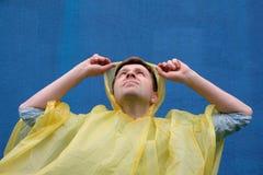 Young unshaven man getting wet under  rain. Stock Photos
