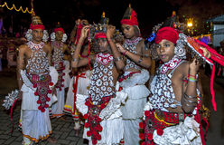 A young Up Country Dancer has his costume adjusted prior to the start of the Esala Perahera in Kandy, Sri Lanka. The Esala Perahera is held to honour the Royalty Free Stock Images