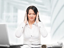Young upset businesswoman working in office Royalty Free Stock Photography