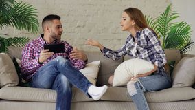 Young upset couple quarrel at home. Indoors royalty free stock images