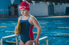 Young upset girl learning to swim in the pool Royalty Free Stock Photo