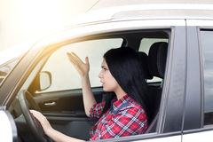 Young upset woman drving car Stock Images