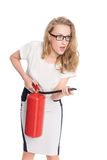Young uptight woman with a fire extinguisher Stock Photos
