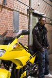 Young Urban African American Male Standing. Next to a Motorcycle Stock Photos