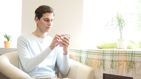 Young urban businessman professional on smartphone texting sms message. Young urban businessman professional on smartphone , using app texting sms message on stock footage