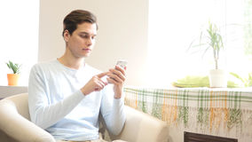 Young urban businessman professional on smartphone texting sms message royalty free stock image