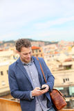 Young urban businessman professional on smartphone. Young urban businessman professional using smartphone using app texting sms message on smart phone wearing Stock Photos