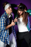 Young urban couple dancers on dark purple light Stock Photo