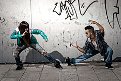 Young urban couple fight acting urban scen. Young urban couple hip hop  dancers fight acting urban scene Stock Image