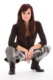 Young urban dance girl in black boots crouching Stock Photos
