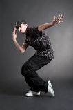 Young urban dancer. Against dark background Royalty Free Stock Photography