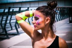 Young urban finess woman with artistic makeup outdoor in the cit. Y sunny summer day royalty free stock images