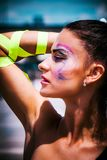 Young urban finess woman with artistic makeup outdoor in the cit. Young urban finess woman portrait with artistic makeup outdoor in the city sunny summer day royalty free stock photos