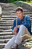 Young urban male model against city street. Royalty Free Stock Image